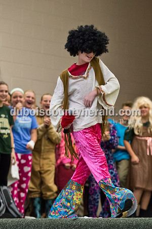 """Cedar Crest Intermediate School sixth-grader Eli Cox donned an afro wig and bell-bottom pants as his classmates laughed backstage during their performance set to the song """"September"""" by Earth, Wind and Fire at the 11th annual lip sync show at the school in Bretzville on Wednesday. Sarah Ann Jump/The Herald"""