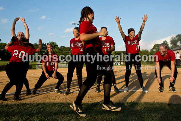 Southridge players held out their hands for high-fives as Lauren Springer, center, approached after being introduced before Thursday's 3A softball sectional semifinal game in Jasper. Southridge defeated Washington 8-5. Sarah Ann Jump/The Herald