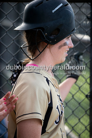 Jasper's Molly Mehringer wore her batting helmet backwards while waiting to go on deck during Monday's Class 3A softball sectional opener against Pike Central in Jasper. The Wildcats defeated Pike Central 3-0. Dave Weatherwax/The Herald