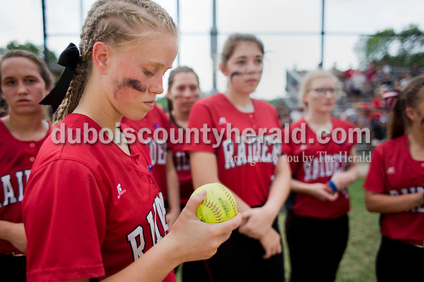 Southridge senior Misty Merter looked at the ball that the team received for finishing as runners-up in Saturday's 3A softball sectional championship game in Jasper. Vincennes Lincoln defeated Southridge 10-2. Sarah Ann Jump/The Herald
