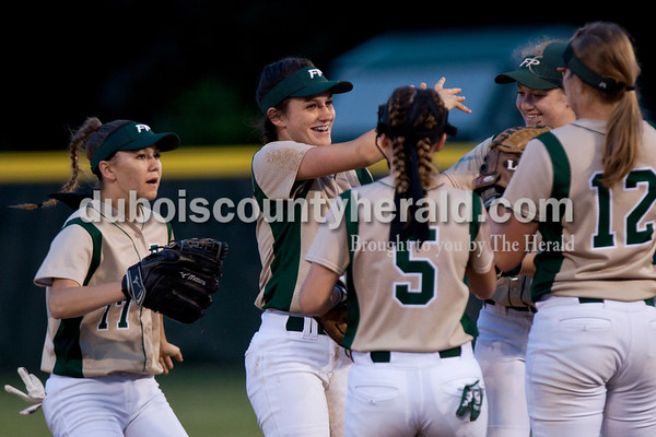 Tegan Johnston/The Herald Forest Park's Macie Zink was congratulated by her teammates after tagging out a North Posey player during Tuesday's IHSAA Class 2A sectional game in Bretzville. Forest Park lost to North Posey in the seventh inning 1-0.