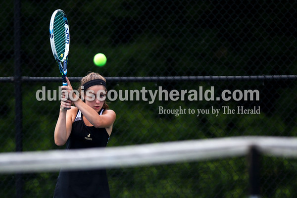 Tegan Johnston/The Herald Jasper's Mallory Ahlbrand returned the ball while competing in the No. 3 singles match during the semistate tennis match on Saturday in Jasper. The Wildcats dumped Evansville Memorial 4-1 for semistate title - it's the 3rd straight state finals berth for the Wildcats.