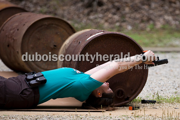 Sarah Ann Jump/The Herald Dubois County Sheriff's Department jail officer Hannah Merter shot at a target during an exercise to practice various shooting positions and taking cover during handgun training at the gun range near Beaver Lake in Jasper on Tuesday afternoon.
