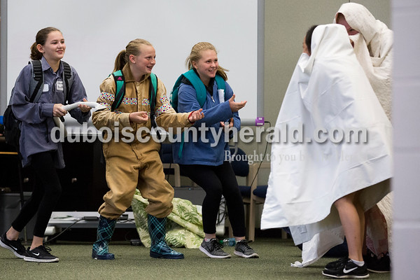 """Cedar Crest Intermediate School sixth-graders Kaylee Berg, left, Karli Kitten and Claire Hagedorn, dressed as Ghost Busters, performed with their classmates to the song """"September"""" by Earth, Wind and Fire during the 11th annual lip sync show at the school in Bretzville on Wednesday. Sarah Ann Jump/The Herald"""