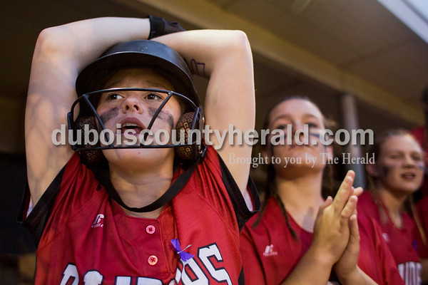 Southridge's Kolby Jones, left, Lauren Springer and Amanda Brewer watched the game from the dugout during Thursday's 3A softball sectional semifinal game in Jasper. Southridge defeated Washington 8-5. Sarah Ann Jump/The Herald
