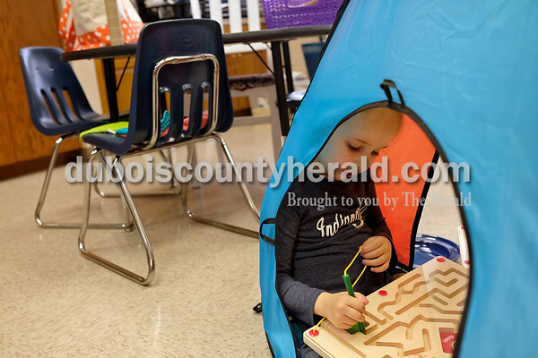Dave Weatherwax/The Herald Holy Trinity Catholic School Pre-K student Katelyn Gray did a maze Monday while sitting in a tent Monday at the Jasper school.