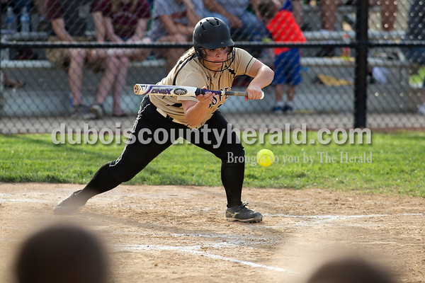 Jasper's Lindsay Mehringer laid down a sacrifice bunt to score a run during Monday's Class 3A softball sectional opener against Pike Central in Jasper. The Wildcats defeated Pike Central 3-0. Dave Weatherwax/The Herald