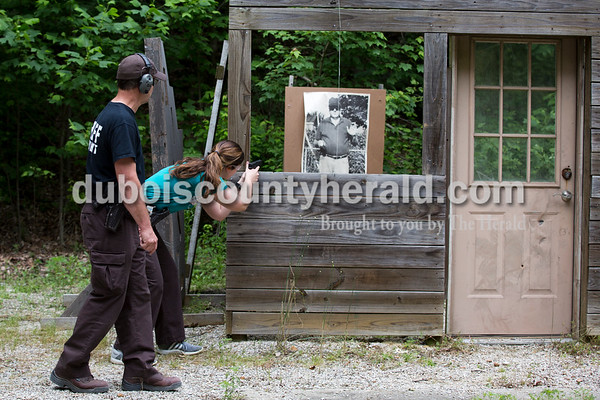 Sarah Ann Jump/The Herald Dubois County Sheriff Lt. Tim Lampert, left, supervised as jail officer Hannah Merter worked her way through a tactical course designed like a house during handgun training at the gun range near Beaver Lake in Jasper on Tuesday afternoon.