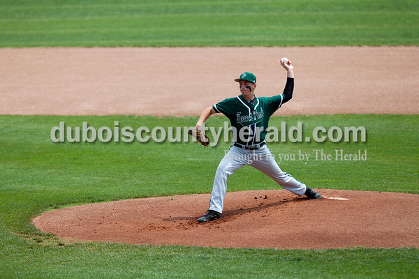 Tegan Johnston/The Herald Forest Park's Reid Brown delivered a pitch during Saturday's game at League Stadium in Huntingburg.