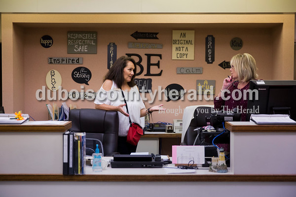 Sarah Ann Jump/The Herald Fifth Street School principal Leah Jessee discussed a plan with administrative assistant Gina Weyer in the main office of the school in Jasper on Wednesday morning.