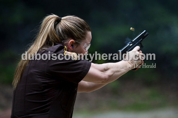 Sarah Ann Jump/The Herald Dubois County Sheriff's Department Deputy Donna Hurt shot a target during the state qualification course for handguns at the gun range near Beaver Lake in Jasper on Tuesday afternoon.