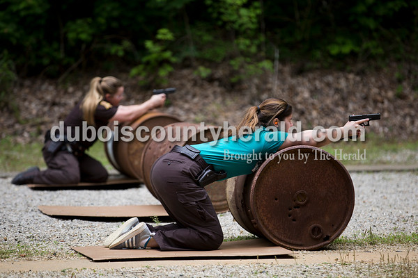 Sarah Ann Jump/The Herald Dubois County Sheriff's Department Deputy Donna Hurt, left, and jail officer Hannah Merter shot at targets during an exercise to practice various shooting positions and taking cover during handgun training at the gun range near Beaver Lake in Jasper on Tuesday afternoon.