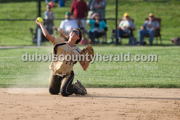 Jasper shortstop Alexa Stenftenagel made the throw to first base after making a diving stop during Monday's Class 3A softball sectional opener against Pike Central in Jasper. The Wildcats defeated Pike Central 3-0. Dave Weatherwax/The Herald