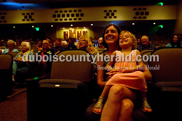 Tegan Johnston/The Herald Negan Schipp of Fulda and her daughter Amelia, 4, watched Bob Ahlemeier of Huntingburg perform a magic show during one of the acts of Friday night's The Very Big Show (of Support) at the Jasper Arts Center in Jasper. The community-wide GIVE WHERE YOU LIVE! fundraising campaign was designed to raise money for the Jasper LEADs (Library, Enrichment, Arts, Downtown) campaign in support of the Cultural Center construction, the renovation and preservation efforts at the historic Astra Theatre, and the renovation of the current Jasper Arts Center.