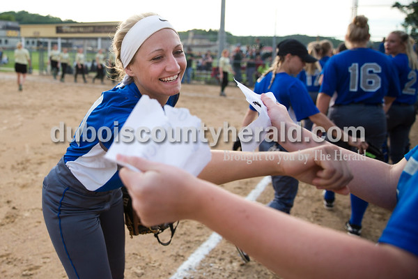 Northeast Dubois' Brooklyn Dodd punched a paper acknowledging she had a diving catch, a way players celebrated various achievements throughout the game, during Monday's 1A softball sectional opener at Springs Valley High School in French Lick. Northeast Dubois defeated Wood Memorial 5-2. Sarah Ann Jump/The Herald