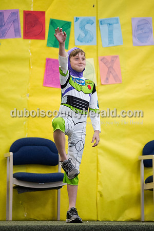 """Cedar Crest Intermediate School fifth-grader Abe Berg played Buzz Lightyear during his class' performance set to songs from the movie """"Toy Story"""" at the 11th annual lip sync show at the school in Bretzville on Wednesday. Sarah Ann Jump/The Herald"""