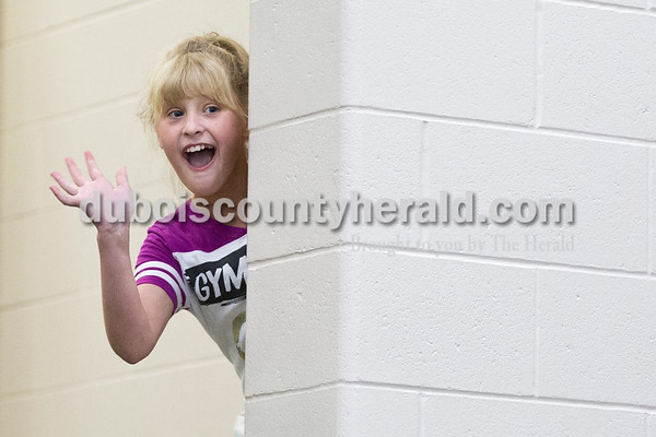 """Cedar Crest Intermediate School fifth-grader Keiara Begle waved from backstage during her class' performance set to the song """"Hello Muddah, Hello Fadduh"""" by Allen Sherman during the 11th annual lip sync show at the school in Bretzville on Wednesday. Sarah Ann Jump/The Herald"""