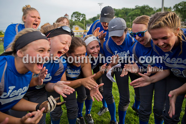 The Northeast Dubois softball team celebrated their win over Wood Memorial in Monday's 1A softball sectional opener at Springs Valley High School in French Lick. Northeast Dubois defeated Wood Memorial 5-2. Sarah Ann Jump/The Herald