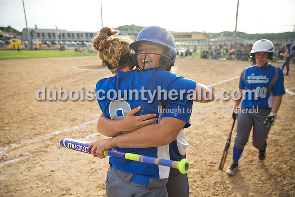 Northeast Dubois' AJ Kirchoff hugged teammate Camryn Stemle as she came off the field after hitting a home run during Monday's 1A softball sectional opener at Springs Valley High School in French Lick. Northeast Dubois defeated Wood Memorial 5-2. Sarah Ann Jump/The Herald