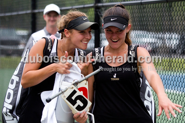 Tegan Johnston/The Herald Jasper's Caroline Theil, left, and partner Olivia Yarbrough celebrated their win after competing in the No. 1 doubles match of Saturday's semistate tennis match in Jasper. The Wildcats dumped Evansville Memorial 4-1 for semistate title - it's the 3rd straight state finals berth for the Wildcats.
