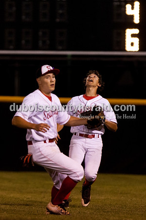 Tegan Johnston/The Herald Southridge's Isaac Englert and Colin Smith looked to catch a fly ball during Thursday's Class 3A sectional championship at Ruxer Field in Jasper. Southridge defeated Washington 7-5.