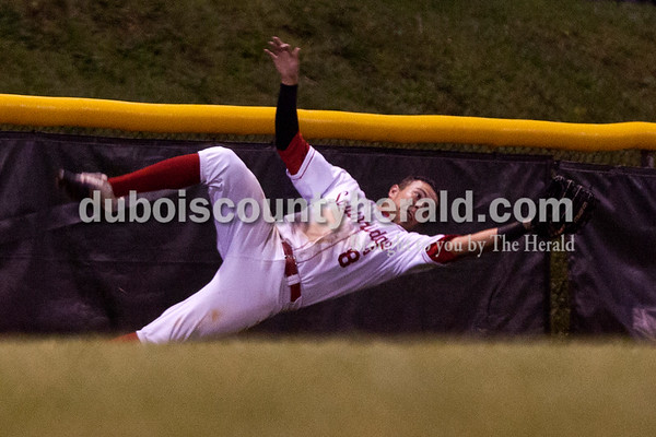 Tegan Johnston/The Herald Southridge's Ross Eckert stretched out to try to catch a ball during Thursday's Class 3A sectional championship at Ruxer Field in Jasper. Southridge defeated Washington 7-5.