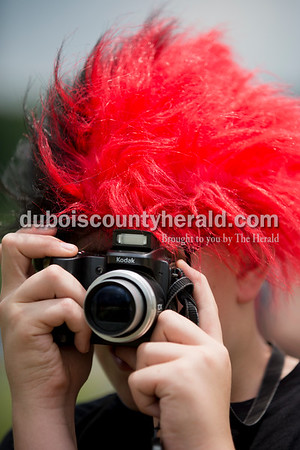 Southridge fan Kamden McKeough of Holland, 12, photographed the action while wearing a black and red wig during Saturday's 3A softball sectional championship game in Jasper. Vincennes Lincoln defeated Southridge 10-2. Kamden is the brother of player Kendyl McKeough. Sarah Ann Jump/The Herald