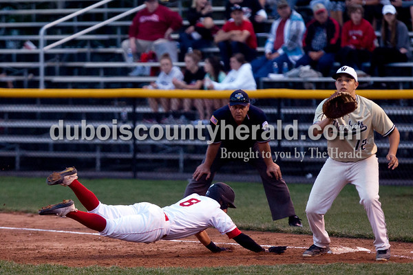 Tegan Johnston/The Herald Southridge's Ross Eckert safely slid back to first after sneaking off the base during Thursday's Class 3A sectional championship at Ruxer Field in Jasper. Southridge defeated Washington 7-5.