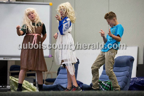 """Cedar Crest Intermediate School sixth-graders Nathan Berg, left, and Luke Hauser, dressed as Barbies, and Leo Alvis danced during their class' performance set to the song """"September"""" by Earth, Wind and Fire at the 11th annual lip sync show at the school in Bretzville on Wednesday. Sarah Ann Jump/The Herald"""