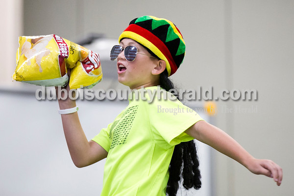 """Cedar Crest Intermediate School fifth-grader Kristopher Fuhrman pretended to sing with a bag of chips during his class' performance set to the song """"Eat It"""" by """"Weird Al"""" Yankovic at the 11th annual lip sync show at the school in Bretzville on Wednesday. Sarah Ann Jump/The Herald"""
