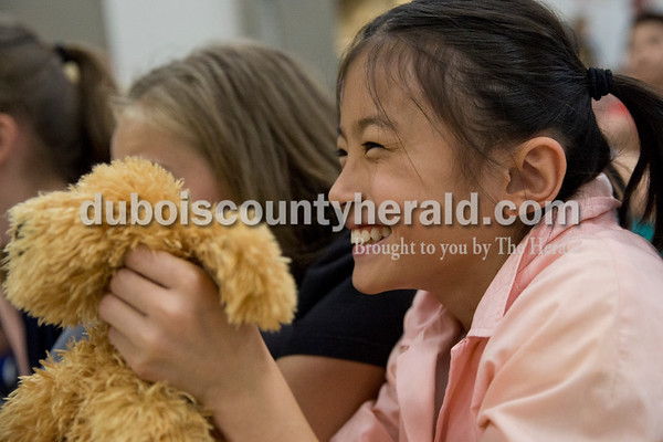 Cedar Crest Intermediate School fifth-grader Adi Becher held up her stuffed animal to encourage a friend on stage during the 11th annual lip sync show at the school in Bretzville on Wednesday. Sarah Ann Jump/The Herald