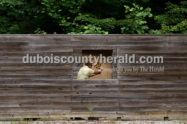 Sarah Ann Jump/The Herald Dubois County Sheriff's Department Detective Sgt. Tom Kleinhelter worked his way through a tactical course during handgun training at the gun range near Beaver Lake in Jasper on Tuesday afternoon.