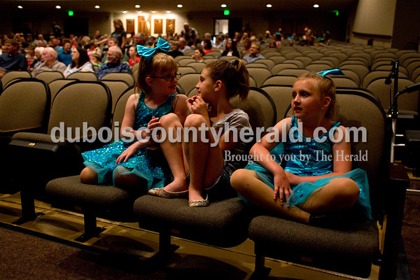 Tegan Johnston/The Herald Addison Randolph, 7, from left, Kenley Lamont, 8, and Khloe Terwiske, 8, sat and watched performances after dancing with Dance Central Academy of Performing Arts during Friday night's The Very Big Show (of Support) at the Jasper Arts Center in Jasper. The community-wide GIVE WHERE YOU LIVE! fundraising campaign was designed to raise money for the Jasper LEADs (Library, Enrichment, Arts, Downtown) campaign in support of the Cultural Center construction, the renovation and preservation efforts at the historic Astra Theatre, and the renovation of the current Jasper Arts Center.