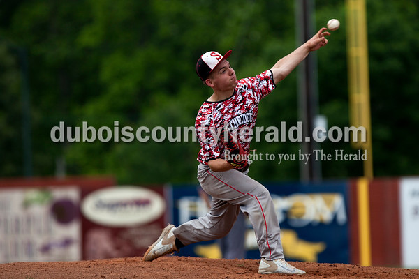 Tegan Johnston/The Herald Southridge's Kade Allen delivered a pitch during Saturday's game at League Stadium in Huntingburg.