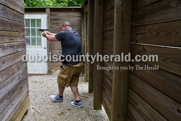 Sarah Ann Jump/The Herald Dubois County Sheriff's Department Deputy Lance Lorey fired at a target in a tactical course designed like a house during handgun training at the gun range near Beaver Lake in Jasper on Tuesday afternoon.