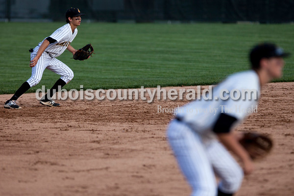 Tegan Johnston/The Herald Jasper's Josh Weidenbenner and Justin Persohn watched the ball to move into position during Thursday's Class 3A sectional championship at Ruxer Field in Jasper. Jasper defeated Vincennes Lincoln 8-4.