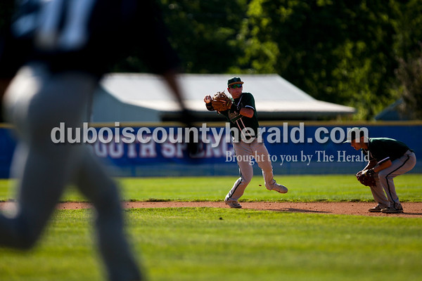 Tegan Johnston/The Herald Forest Park's Trever Zink threw the ball to first base for an out during Friday's Class 2A sectional semifinal game at Joe Hargis Field in Rockport. South Spencer defeated Forest Park 9-1.