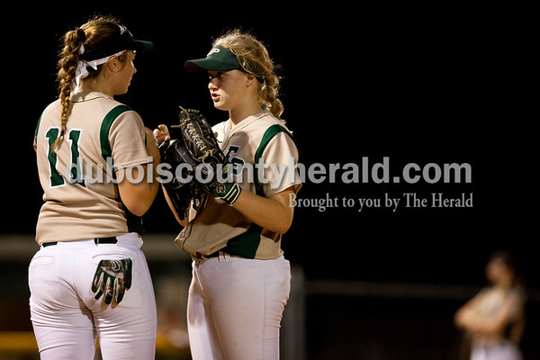 Tegan Johnston/The Herald Forest Park's Kylie Giesler, right, talked to Sara Helming during a break in Tuesday's IHSAA Class 2A sectional game in Bretzville. Forest Park lost to North Posey in the seventh inning 1-0.