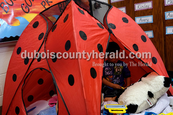 Dave Weatherwax/The Herald Holy Trinity Catholic School Pre-K student Leo Thomas administered a shot to a pillow pet while playing in a tent Monday at the Jasper school.