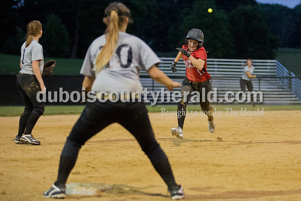 Southridge's Kolby Jones ran to third base and slid in safely before the ball arrived in the mitt of Washington's Emily Kennedy during Thursday's 3A softball sectional semifinal game in Jasper. Southridge defeated Washington 8-5. Sarah Ann Jump/The Herald