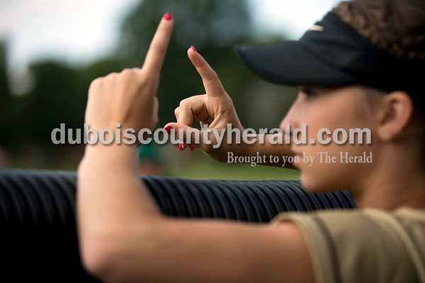 Jasper's Hailey Hurst held up a pair of ones as she rooted for her teammates during Thursday's 3A softball sectional semifinal game in Jasper. Vincennes Lincoln defeated Jasper 1-0. Sarah Ann Jump/The Herald