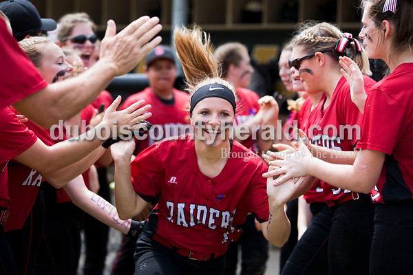 Southridge's Peyton Nalley high-fived her teammates as she ran onto the field during player introductions before Saturday's 3A softball sectional championship game in Jasper. Vincennes Lincoln defeated Southridge 10-2. Sarah Ann Jump/The Herald