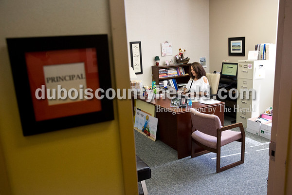 Sarah Ann Jump/The Herald Fifth Street School principal Leah Jessee answered emails in her office at the school in Jasper on Wednesday morning.