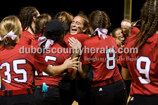 Southridge's Boo Polley, center, who pitched the final half of the game, was rushed by her teammates as they celebrated winning Thursday's 3A softball sectional semifinal game in Jasper. Southridge defeated Washington 8-5. Sarah Ann Jump/The Herald