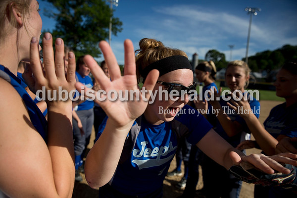 Northeast Dubois' AJ Kirchoff high-fived her teammates while running onto the field as she was introduced before Monday's 1A softball sectional opener at Springs Valley High School in French Lick. Northeast Dubois defeated Wood Memorial 5-2. Sarah Ann Jump/The Herald