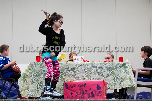 """Cedar Crest Intermediate School fifth-grader Luli Schipp roller bladed across the stage during her class' performance set to the song """"Eat It"""" by """"Weird Al"""" Yankovic at the 11th annual lip sync show at the school in Bretzville on Wednesday. Sarah Ann Jump/The Herald"""