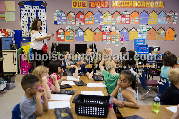 Sarah Ann Jump/The Herald Fifth Street School principal Leah Jessee documented a kindergarten class to post social media at the school in Jasper on Wednesday morning.