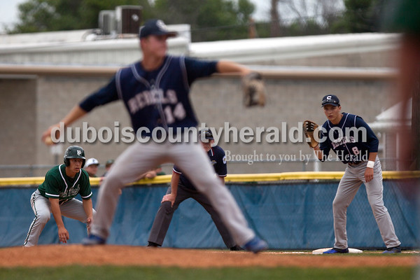 Tegan Johnston/The Herald Forest Park's Elliott Rothgerber snuck off first base during Friday's Class 2A sectional semifinal game at Joe Hargis Field in Rockport. South Spencer defeated Forest Park 9-1.