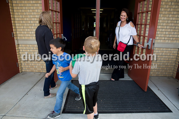 Sarah Ann Jump/The Herald Fifth Street School principal Leah Jessee held the door for students as they went out to recess at the school in Jasper on Wednesday morning.