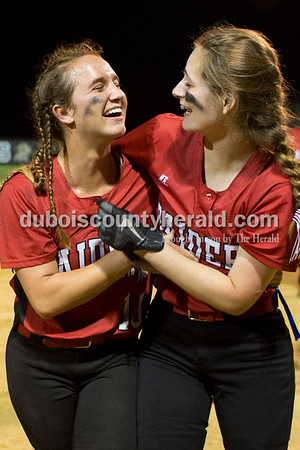 Southridge's Boo Polley and Shelby Worden hugged as they walked off the field while celebrating the Raider's win in Thursday's 3A softball sectional semifinal game in Jasper. Southridge defeated Washington 8-5. Sarah Ann Jump/The Herald
